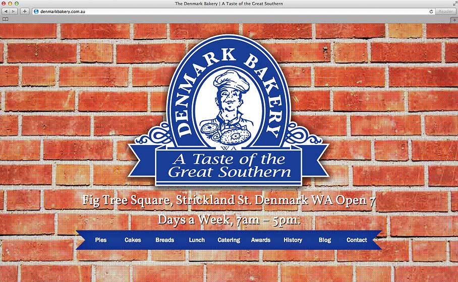 Denmark Bakery home page screen shot with a red brick wall and their blue logo.